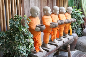 row of monk statues